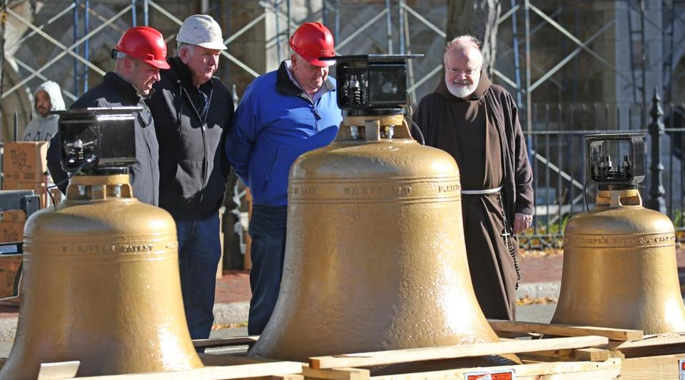 Cardinal Sean Patrick O'Malley viewed the bells before they were placed.